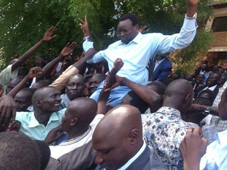 Dr. Majak D'agoot being carried high on the shoulders by his supporters and relatives upon release from detention
