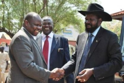 SPLM chairman Salva Kiir (R) greets former SG Pagan Amum (L) as Riek Machar looks on, January 14, 2010