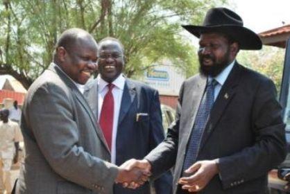 SPLM chairman Salva Kiir (R) greets former SG Pagan Amum (L) as Riek Machar looks on, January 14, 2010