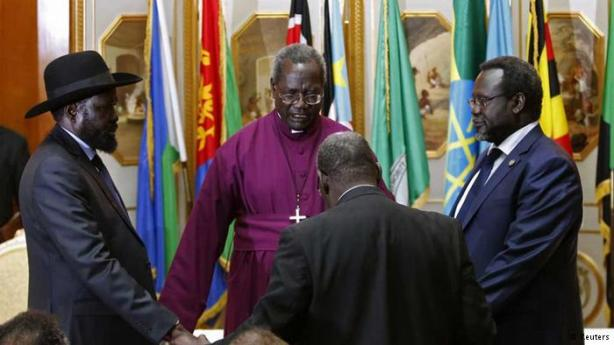 Bishop Deng Bul (in red), praying with President Kiir and Dr. Riek Machar, Addis Ababa, Ethiopia