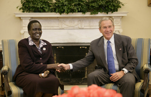 President George W. Bush welcomes Rebecca Garang,  the Minister of Transportation, Roads and Bridges of the Government of  Southern Sudan, to the Oval Office, Friday, Feb. 10, 2006 at the White House.  White House