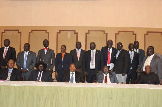Mabioor Garang's hands on President Kiir's shoulders?