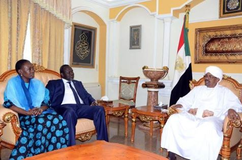 Riek Machar and his wife, Angelina Jany Teny, in Khartoum with President Omar Bashir
