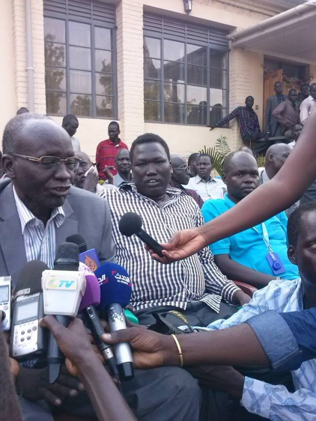 Mading Akueth, with Isaiah Chol Aruai, and Aleer Longar, speaking to reporters on their arrival in Juba after two days in captivity