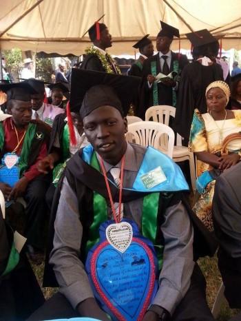 Mathuc Mayuol on Gradauting day in Uganda, Mathuc Mayuol in his likeness-Juba