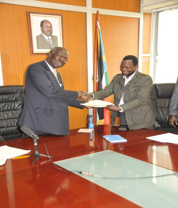 Dak Buoth shaking Hands with South Sudan Ambassador to Kenya H.E Mariano Deng after signing students' concord at the Embassy Premises in June 2015