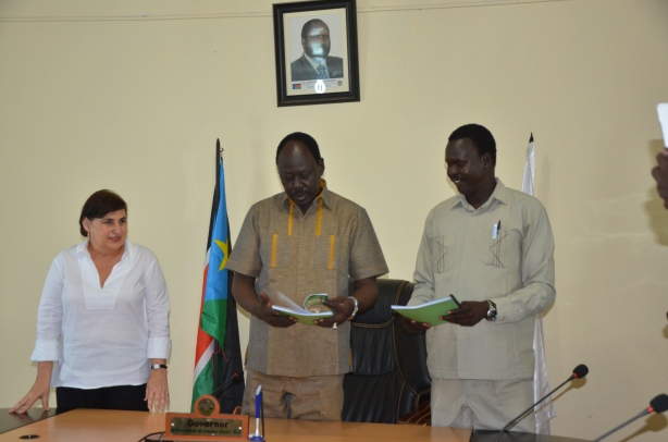H.E. Philip Aguer, UNMISS HoFo and minister for information receing the constitution form commitee.JPG