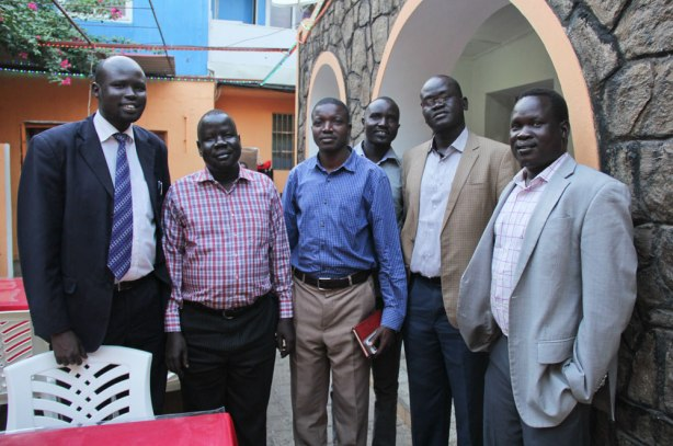 JRS scholars - This group of men are former refugees assisted by JRS in the 80s and 90s while they were in exile in Kakuma. Many were resettled or went on to attain higher education in Kenya. They have now returned to their home country to contribute back to society. (Angela Wells / Jesuit Refugee Service)