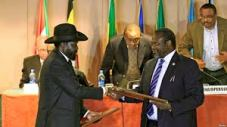 President Kiir & Dr.Reik Machar shake hands after signing the agreement in Addis Ababa, Ethiopa